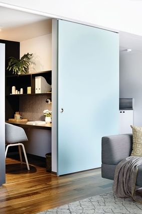 A study alcove can be visually separated from the living room by a coloured sliding panel. Smith St Apartment by Neometro