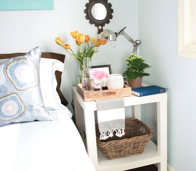 21 IKEA Nightstand Hacks Your Bedroom Needs via Brit + Co. - How can you make the IKEA Lack table the right height for a bedside table? Attach one table to the top of another and enjoy all that extra room that comes with a second shelf.