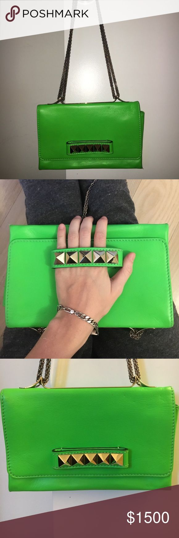 NEW knuckle Valentino Neon Green Cross body purse ON SALE 🚨. WORN ONCE. Hand knuckle Neon Green Valentino cross body purse with stud detail and chain straps to make it long, short or wear it as a clutch. Looks BRAND NEW. Comes with DUST bag. TAKING OFFERS! Valentino Bags Shoulder Bags