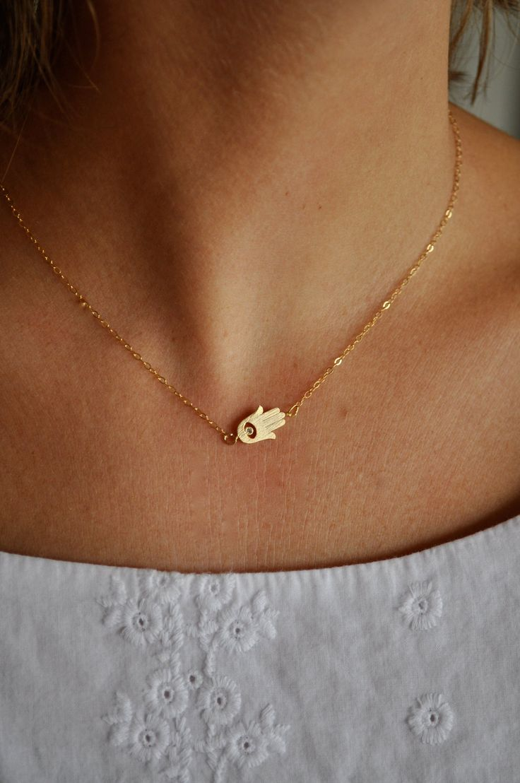 Tiny Gold Sideways Hamsa Necklace, meant to ward off the evil eye