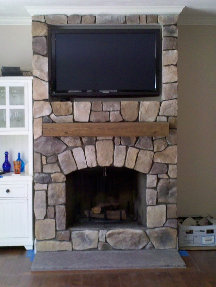 Living room small byt elegant stone fireplace idea with for Small living room with fireplace and tv