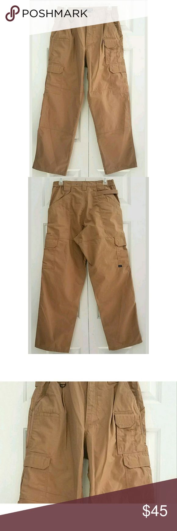 "5.11 Tactical Series Cargo Pants Size 30 X 30 Men's 511 5.11 Tactical Series Cargo Pants Size 30X30 Style 74273  In pre-loved gently cared for condition. No holes or rips.  Measurements laying flat. Please view measurements for proper fit before purchasing.  Waist- 13"" Inseam- 29""  Thank you for your interest and taking the time to look at my items. Have a great day! 5.11 Tactical Pants Cargo"