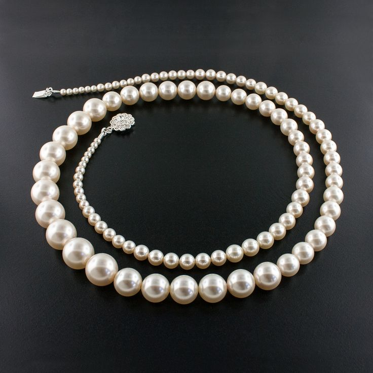 "36"" Graduated Pearl Necklace - Made with Swarovski® pearl and crystal embellished clasp.  Assembled in USA."