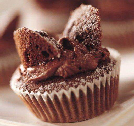 Chocolate Butterfly Cakes Recipe: These chocolate fairy cakes are simple and delicious! - One of hundreds of delicious recipes from Dr. Oetker!