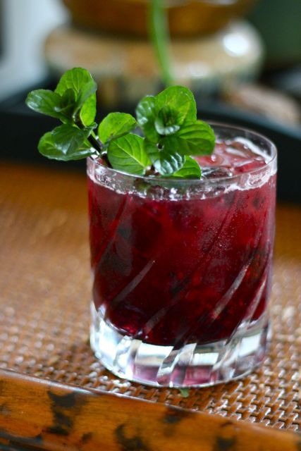 1 oz gin  6-7 frozen blackberries  2 oz. tonic  1 tsp. lime juice    // Instructions //    In an empty rocks glass, muddle frozen blackberries. Then fill the glass with ice.  Add gin, tonic and lime juice.  Stir and garnish with fresh mint sprigs.