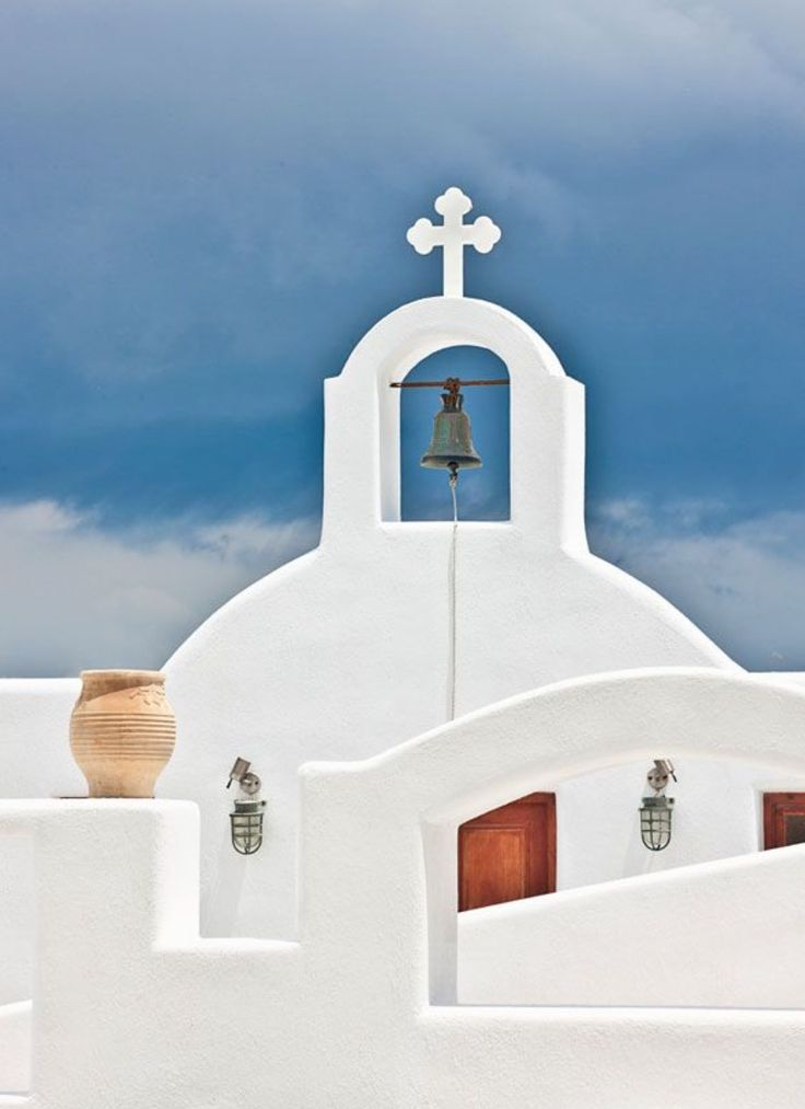 A beautiful church in Oia village, Santorini island, Greece - Selected by www.oiamansion.com
