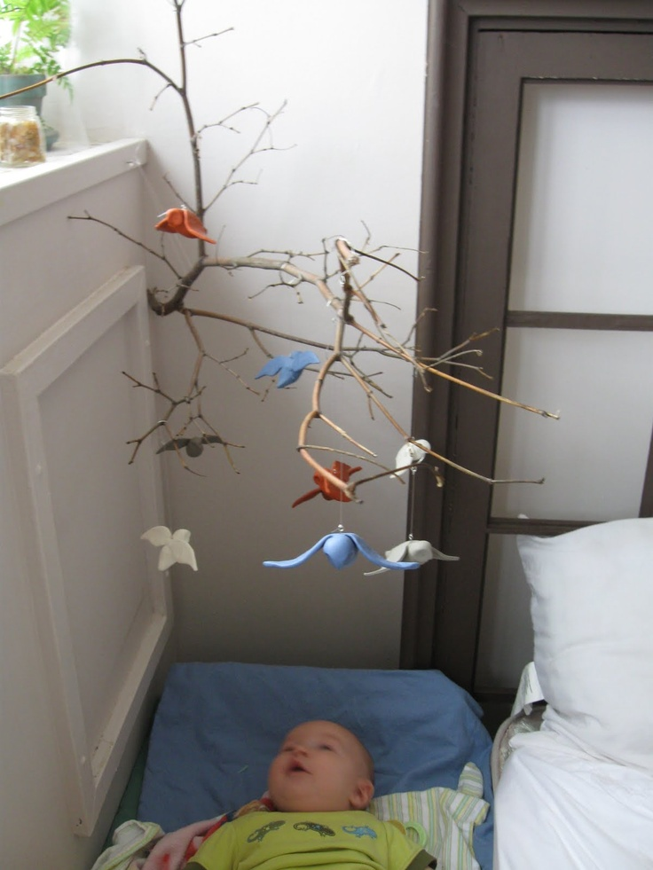 I love this homemade baby mobile. Use the soft foam clay for the birds!!! Maybe add some twinkle lights too