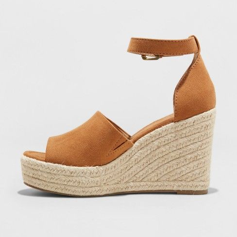 335042c113ea Elevate your style any day with the comfortable fit of the Emery Espadrille  Sandals from Universal Thread™. These peep-toe wedge heels keep things …
