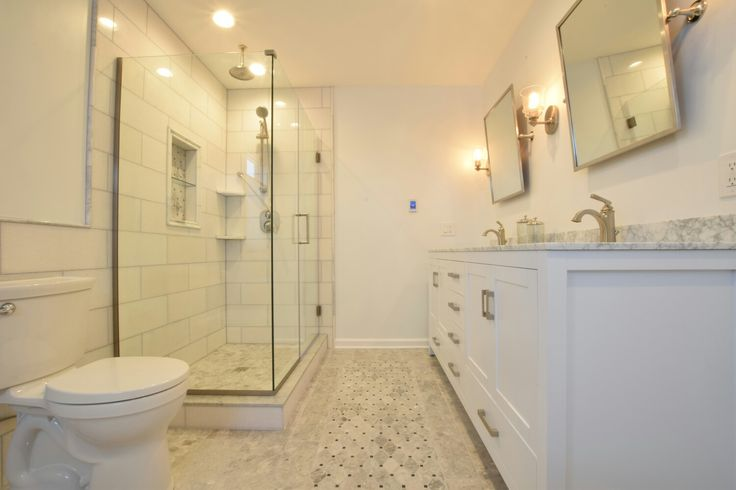 Carrera Marble with dreamline shower heated tile carpet with vanity white bathroom