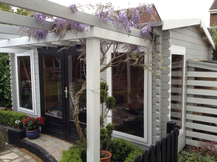 Garden studio summer house in grey, white and black with pergola