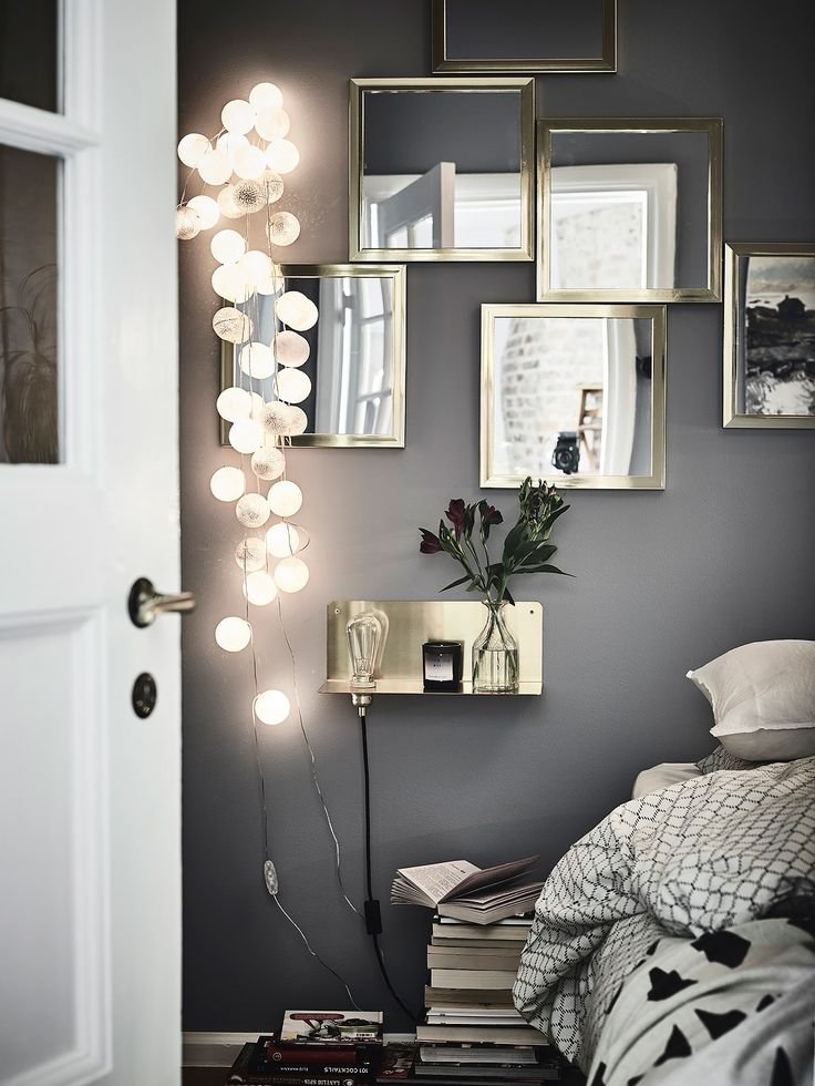 Bedroom details in a gothenburg apartment with a bold dark bedroom gravity home glowing accents in an interior scheme string light bulbs bedroom lights