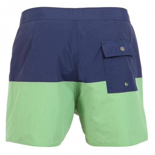 BLUE AND GREEN NYLON MID-LENGTH BOARDSHORTS Ennis blue and green color block design nylon swim shorts. Fixed waist with drawstring and Velcro closure Back snap-button pocket. Inside lining. Saturdays Surf NYC label stitched on hem. COMPOSITION: 100% NYLON. Model wears size 32, he is 189 cm tall and weighs 86 Kg.