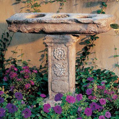 Mediterranean bird bath. Made of cast stone in the USA
