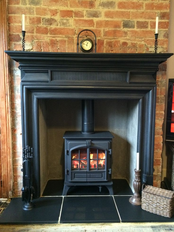Living Room - Carron Belgrave Cast Iron Surround. Stovax Riva Plus Midi Woodburning Stove. Black Slate hearth.