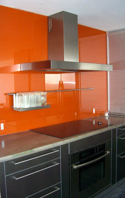 What do you think of this bright orange painted glass backsplash?