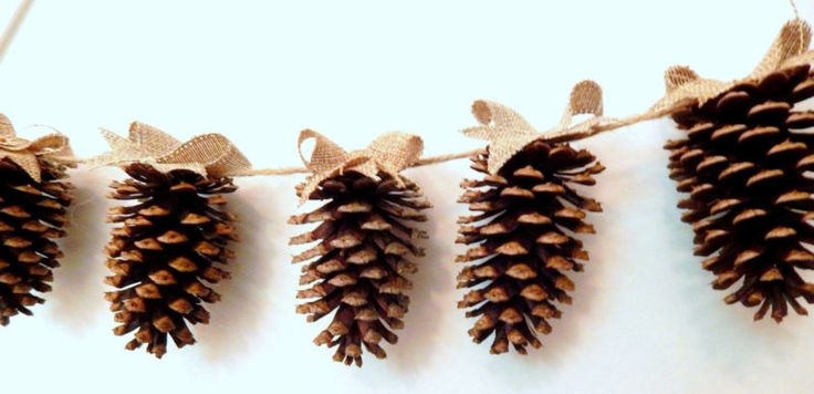 Pinecone Garland Screw an eye hook onto the back of pinecones to make ornaments or garland. Spray paint them with gold paint, brush white tips on them, or add a burlap ribbon to the tops.