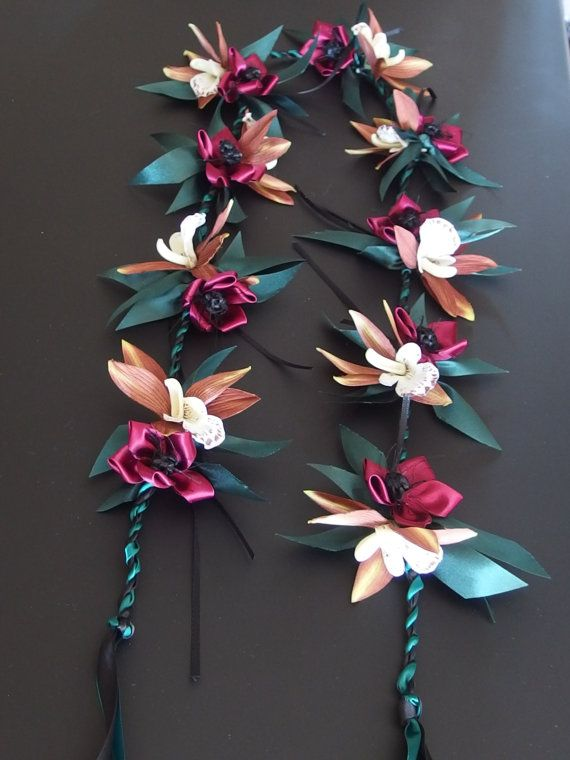 The lei is approximately 46 inches long open end lei material/satin ribbon, acetate ribbon and silk flower