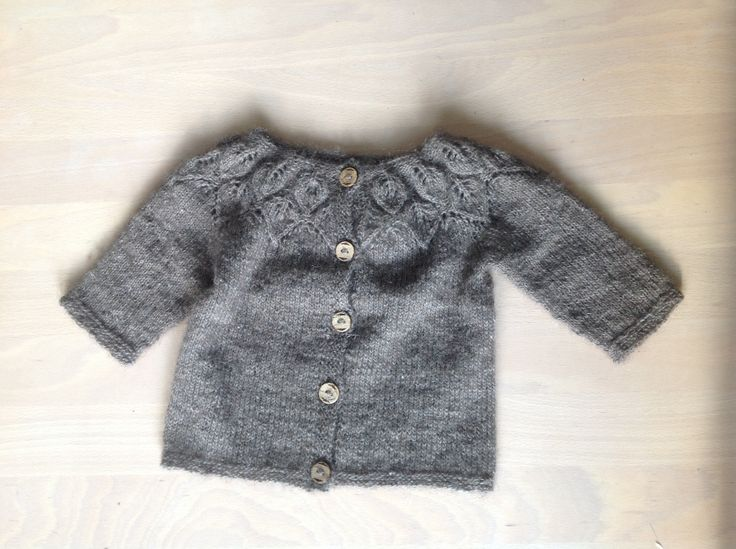 Babycardigan made from moskus yarn.  Its weight is as little as 32 grams.
