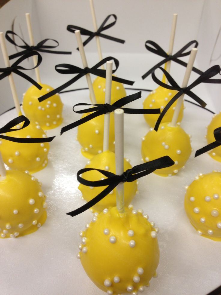 Black white and yellow cake pops. By Cake Designs Las Vegas