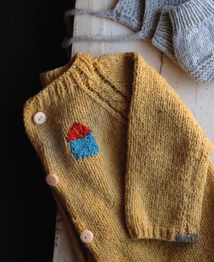 Mending on hand knit baby sweater by Sugarhouse Workshop @sugarhouseworkshop