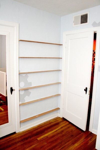 See how to nail strips of baseboard behind your bedroom for Bookshelf behind bed