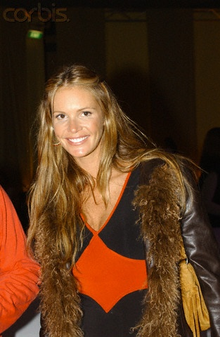 Elle macpherson with long hair pulled back in barrettes a simple