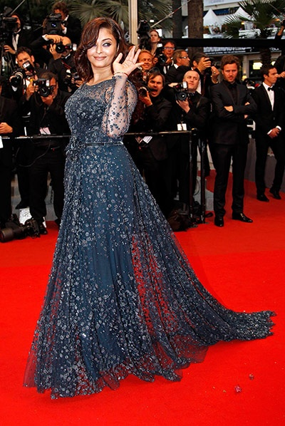 """Aishwarya Rai at Cannes 2012 - I can't believe people are giving her such a hard time. She had a baby. She CHOSE to not go insane to get the baby weight off. It's probably the healthiest route for her, and yet all people can say about a woman who has done so much is """"she got fat""""?!?!? I hate this planet sometimes."""