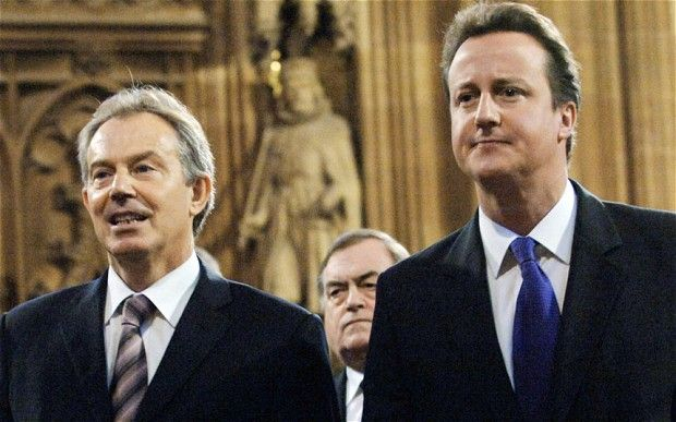 Tony Blair (left) walking through the Central Lobby of the House of Commons with  David Cameron at the State Opening Of Parliament in London...