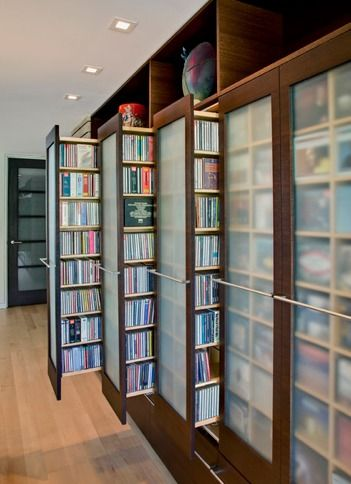 By John Senhauser Architects. If you love books but would rather spend your time reading over cleaning them, this would be a great way to store and organize them.