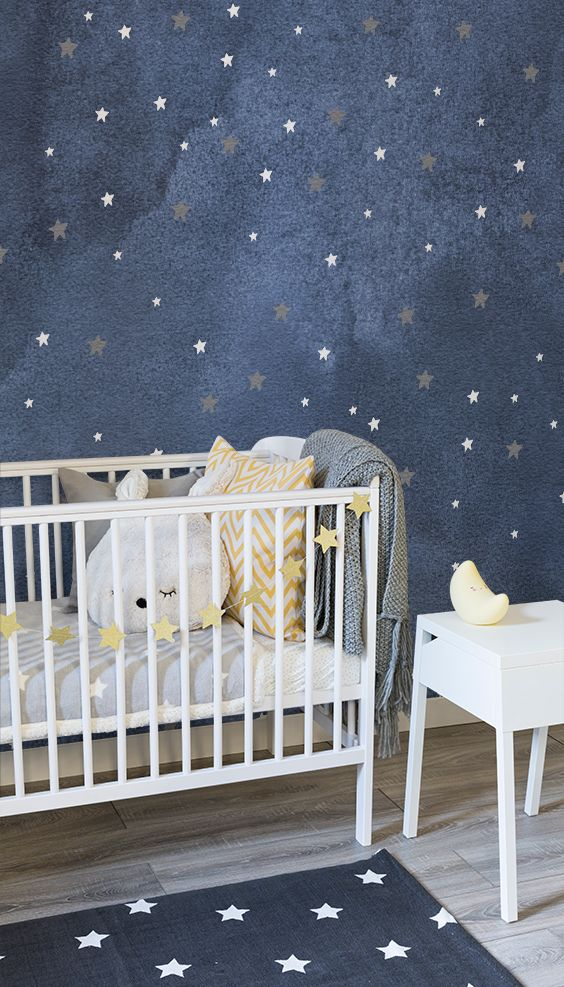 Fall asleep under the starry night with this beautiful nursery wallpaper. Silver and white stars are speckled against a blue watercolour background. Pair with dreamy accessories like this lovely moon light.