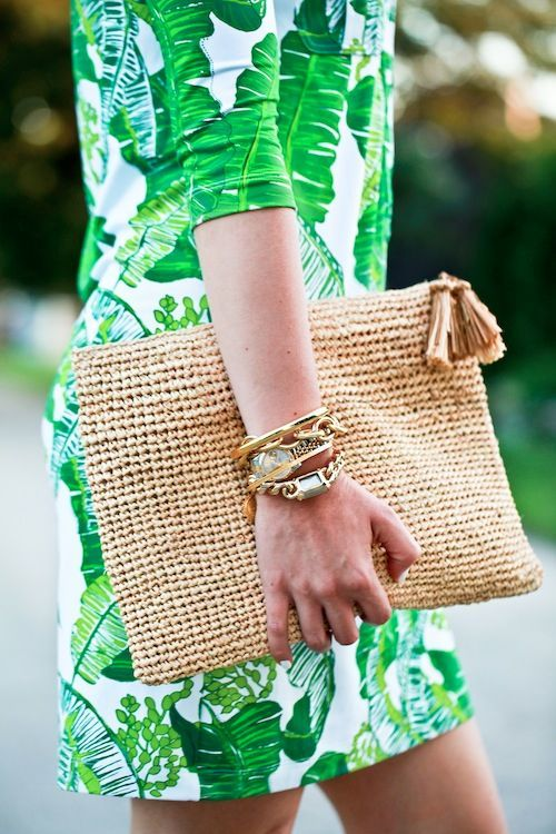J. Crew palm print shift, woven fold-over clutch, and gold bangles.