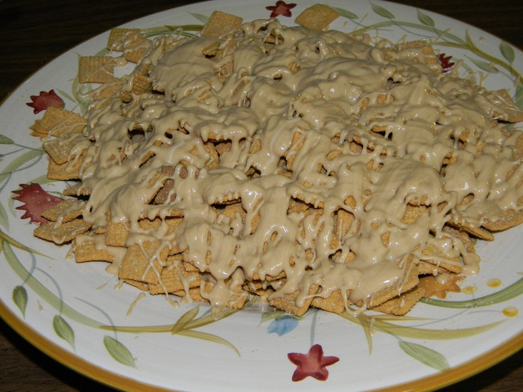 Golden Grahams covered with a mix of melted white chocolate almond bark and peanut butter. Delicious!