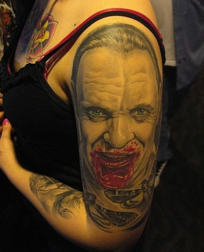 silence of the lambs - i love tattoos. i love silence of the lambs. this just seems like a horrible idea. nice arm, lady....