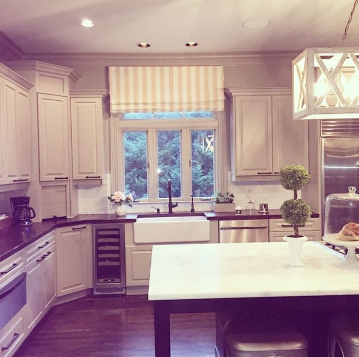 Jessie James Decker home decor..I love above the sink...soooo much cleaner looking than having crap hanging.