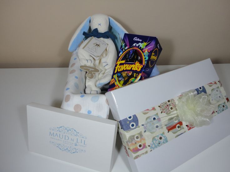 We love to design unique custom hampers    that will delight our clientele and their gift recipients.This gorgeous hamper was created to welcome a precious new baby into the world. It features Cadburys chocolates, muslin wraps and an adorable organic cotton 'Ears the Bunny' comforter from Maud 'N' Lil Organic Cotton Toys.