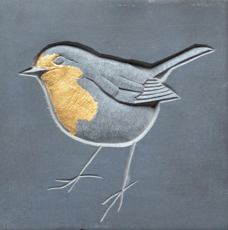 Slate carving of a Robin, with gilding by Louise Tipaldy. This artwork will be on display as a part of The Space Between, an exhibition that celebrates the art of lettering at Snape Maltings