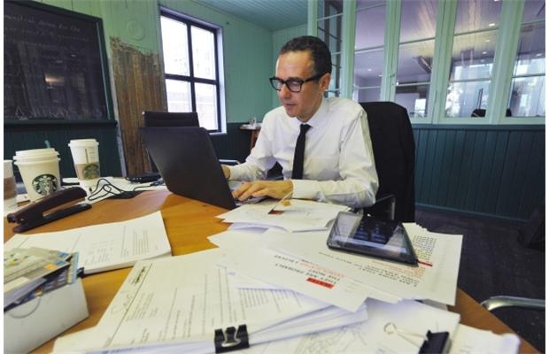Bob Rennie works on his speech at his Vancouver office ahead of his address at the Urban Development Institute Vancouver's gathering on Thursday, May 16, 2013. Boomers will continue to drive the Vancouver real estate market, he says.
