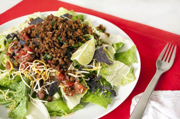 Taco Salad  Shopping List: 85% lean ground beef, taco seasoning, romaine lettuce, shredded mexican cheese, salsa, scallions + lime, avocado