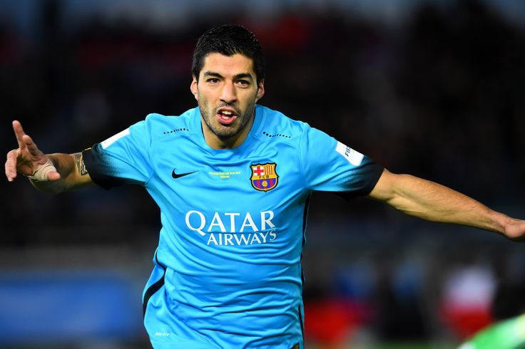 Luis Suarez of Barcelona celebrates after scoring during the FIFA Club World Cup Semi Final match between Barcelona and Guangzhou Evergrande FC at International Stadium Yokohama on December 17, 2015 in Yokohama, Japan.