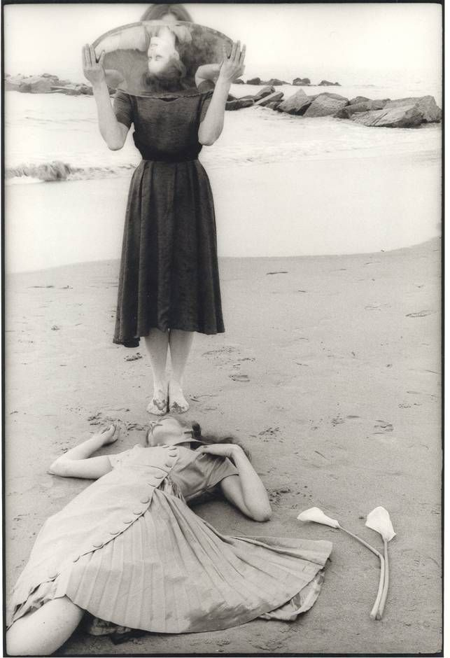"Francesca Woodman, Untitled, Providence, Rhode Island, 1975-1978.  ""...A woman apparently dead at the lip of the ocean, reflected in the mirror of another woman whose own face is displaced by that very mirror."""
