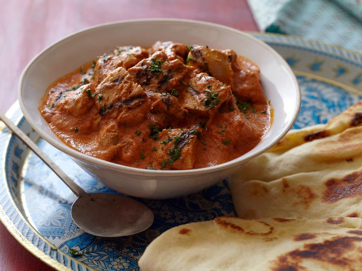 Chicken in Creamy Tomato Curry: Chicken Tikka Masala from FoodNetwork.com. Light cream works well. The Ginger-Garlic Paste is also delicious in pasta sauce and teriyaki marinades. Naan is found in most grocery store bakeries. My kids love this!
