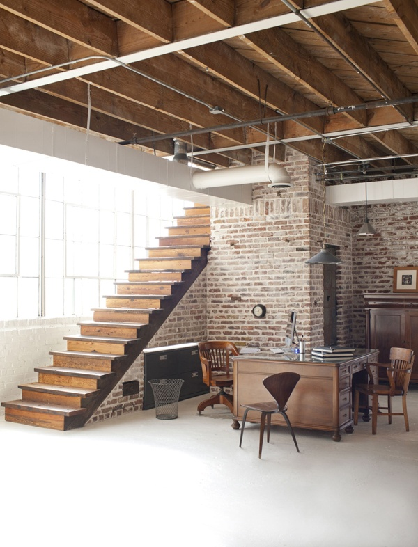Love the exposed brick wall, staircase and light in this space