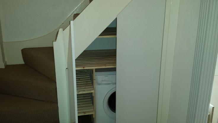 Washing machine under stairs
