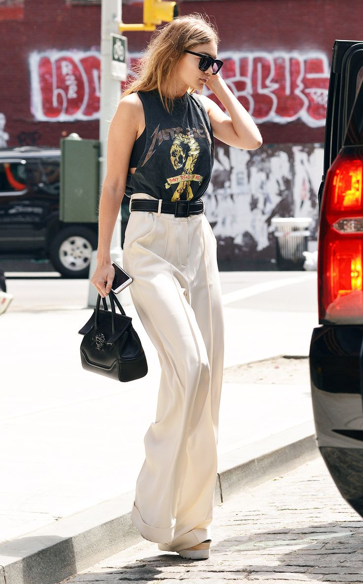 Gigi Hadid looking MEGA in her Metallica T-shirt and tailored flares. But should band tees be just be saved for fans? Discuss...