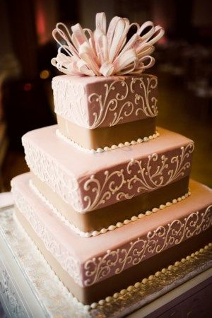 square three tiered pink and tan wedding cake with white filigree embellishments - photo by Orange County wedding photographer Amelia Lyon
