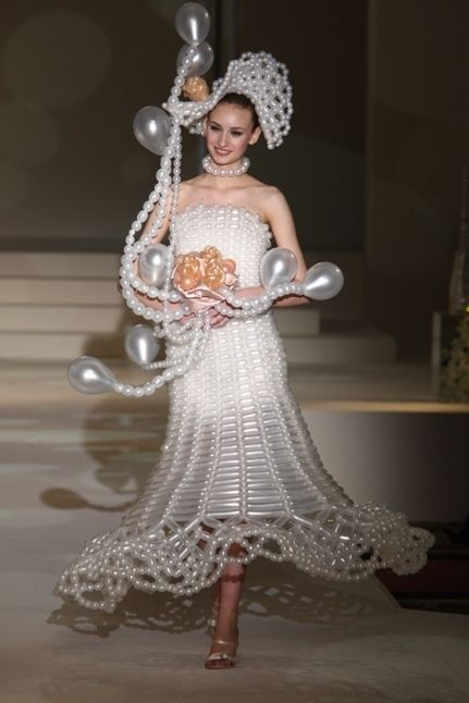 Balloon Wedding Dress | The 14 Most Insane Wedding Dresses Of All Time  I vote NO on #14.  Please Gab...  If you love us.