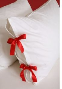 Ribbon added to a plain pillowcase turns it into a one-of-a-kind sham.