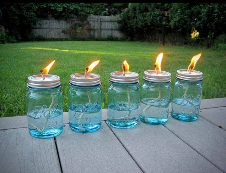 Citronella Mason Jar Lanterns |  Aren't these a beautiful way to keep bugs at bay for your evening spa party?  Lovely, easy, and effective.