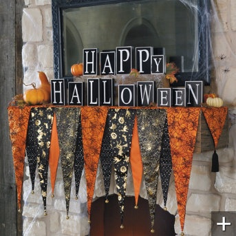I think I could totally make this. Plus it's waaaaay too long for my mantel. Bewitching Halloween Mantel Scarf