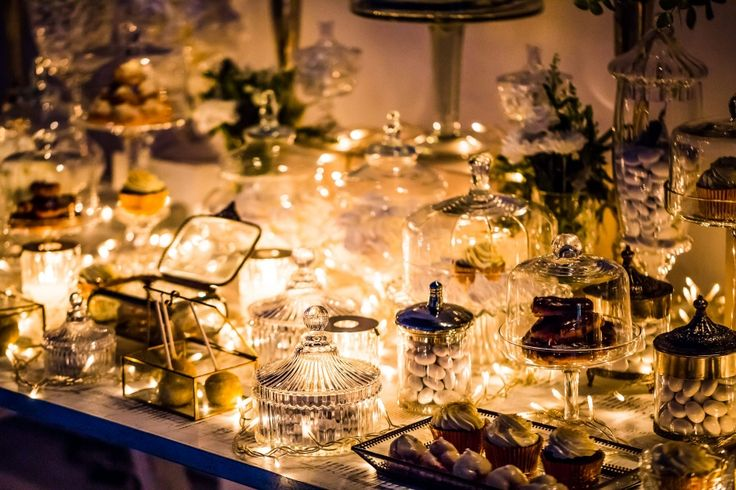 Sweets table with cake pops, cupcakes, eclairs, macarons, koufeta...indulge yourselves!
